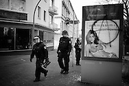 Germany, Frankfurt am Main :  Riot policemen walk past a damaged billboard during a demonstration on the opening day of the European Central Bank (ECB) in Frankfurt am Main, western Germany, on March 18, 2015<br /> <br /> .