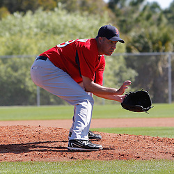 February 19, 2011; Fort Myers, FL, USA; Boston Red Sox relief pitcher Scott Atchison (48) during spring training at the Player Development Complex.  Mandatory Credit: Derick E. Hingle