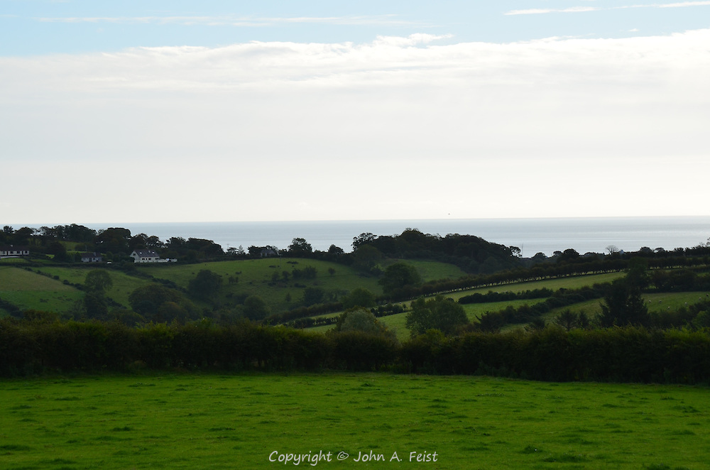 Some of the lush green farmland in Cushendall, County Antrim, Northern Ireland. The land leads right to the sea