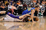 Apr 5, 2013; Phoenix, AZ, USA; Golden State Warriors guard Stephen Curry (30) and Phoenix Suns guard Goran Dragic (1) dive for the loose ball during in the first half at US Airways Center. Mandatory Credit: Jennifer Stewart-USA TODAY Sports