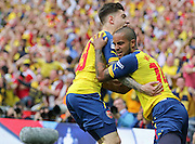 Arsenal's Héctor Bellerín celebrates with Arsenal's Theo Walcott after his goal during the The FA Cup match between Arsenal and Aston Villa at Wembley Stadium, London, England on 30 May 2015. Photo by Phil Duncan.