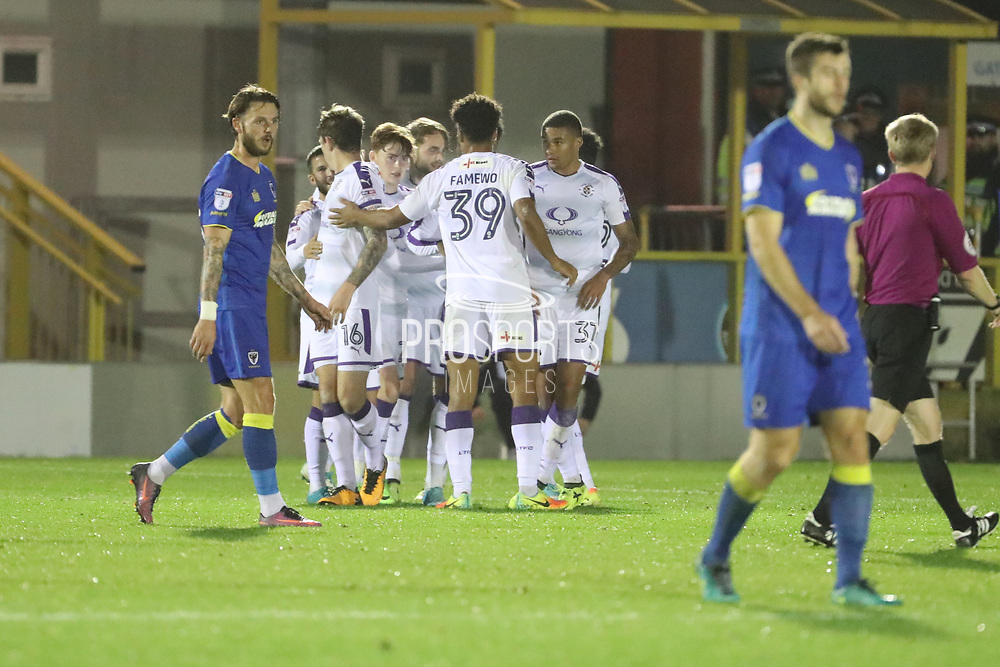 Luton Town midfielder Andrew Shinnie (11) celebrating after scoring goal to make it 1-2 during the EFL Trophy match between AFC Wimbledon and Luton Town at the Cherry Red Records Stadium, Kingston, England on 31 October 2017. Photo by Matthew Redman.