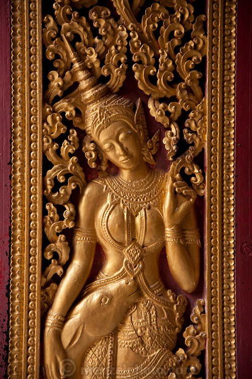 Gilded door carving at the Wat Xieng Thong  Buddhist temple complex, Luang Prabang, Laos