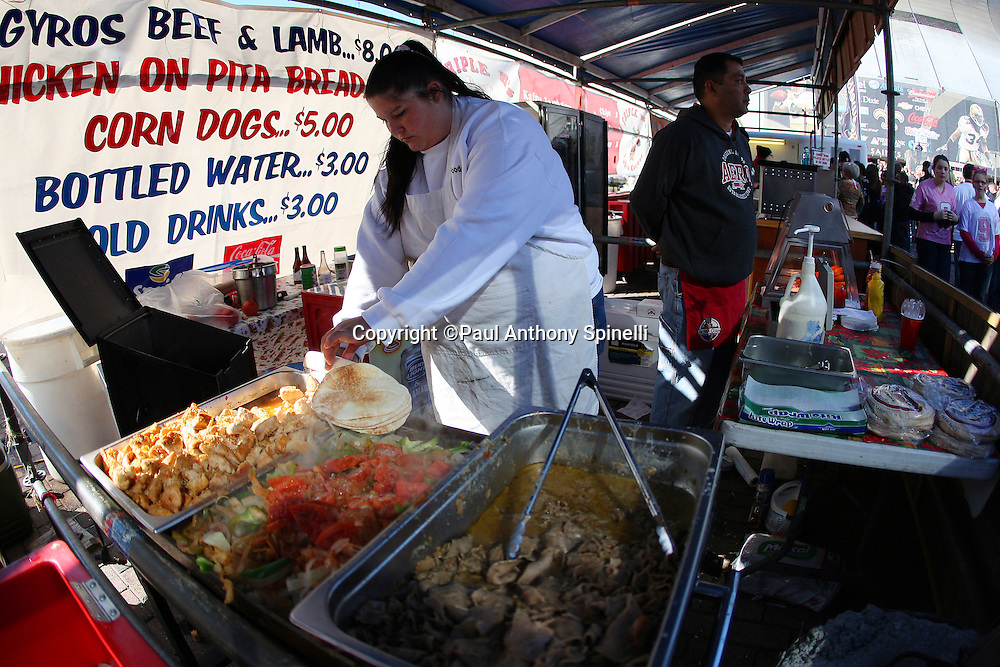 NEW ORLEANS - DECEMBER 07: A food vendor serves meals outside the stadium before the New Orleans Saints game against the Atlanta Falcons at the Louisiana Superdome on December 7, 2008 in New Orleans, Louisiana. The Saints defeated the Falcons 29-25. ©Paul Anthony Spinelli