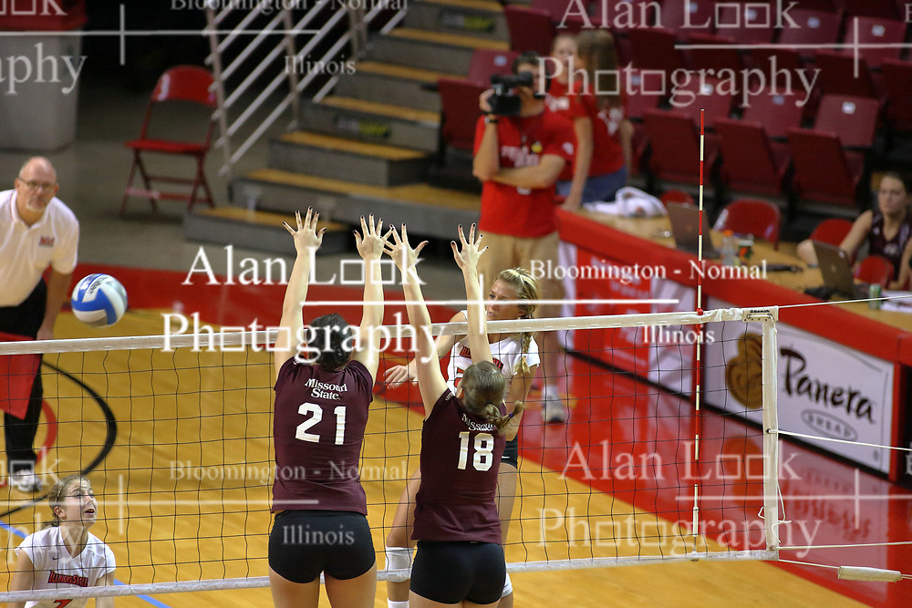 31 OCT 2008: Mallory Leggett strikes the ball to the inside of the dual block attempt by Calli Norman and Julia Cawthra during a match in which the Missouri State Bears defeated the Redbirds of Illinois State 3 sets to 2 on Doug Collins Court inside Redbird Arena in Normal Illinois