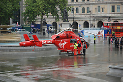 © licensed to London News Pictures. London, UK  05/05/11 Air Ambulance lands today in London's Trafalgar Square to help a man who had fallen from scaffolding in Whitehall.  the victim was subsequently taken to hospital by conventional ambulance  . Please see special instructions for usage rates. Photo credit should read AlanRoxborough/LNP