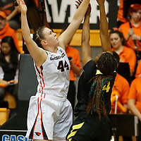 Oregon State's Ruth Hamblin, left, blocks the shot of Oregon's Jillian Alleyne in the second half of an NCAA college basketball game, in Corvallis, Ore., on Friday, Jan. 8, 2016. Oregon State won 60-33. (AP Photo/Timothy J. Gonzalez)