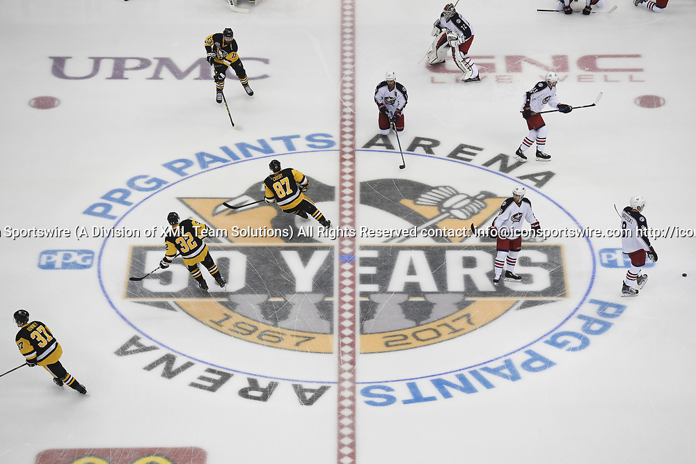 PITTSBURGH, PA - APRIL 12: PITTSBURGH, PA -  General view of the Pittsburgh Penguins 50 Year Anniversary logo as players warm up at center ice before Game One of the Eastern Conference First Round during the 2017 NHL Stanley Cup Playoffs on April 12, 2017, at PPG Paints Arena in Pittsburgh, PA. (Photo by Jeanine Leech/Icon Sportswire)