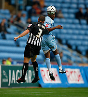 Photo: Steve Bond.<br />Coventry City v Notts County. The Carling Cup. 14/08/2007. Ellery Cairo (R) nodds on as Austin McCann defends (L)