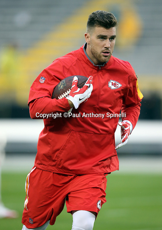 Kansas City Chiefs tight end Travis Kelce (87) runs with the ball after catching a pass as he warms up before the 2015 NFL week 3 regular season football game against the Green Bay Packers on Monday, Sept. 28, 2015 in Green Bay, Wis. The Packers won the game 38-28. (©Paul Anthony Spinelli)