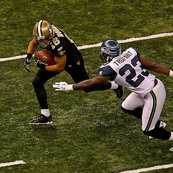 November 21, 2010; New Orleans, LA, USA;  New Orleans Saints wide receiver Lance Moore (16) is pursued by Seattle Seahawks cornerback Marcus Trufant (23) during the first quarter at the Louisiana Superdome. The Saints defeated the Seahawks 34-19. Mandatory Credit: Derick E. Hingle