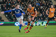 Aron Gunnarsson (Cardiff City) clears the ball from David Meyler (Hull City) during the Sky Bet Championship match between Hull City and Cardiff City at the KC Stadium, Kingston upon Hull, England on 13 January 2016. Photo by Mark P Doherty.