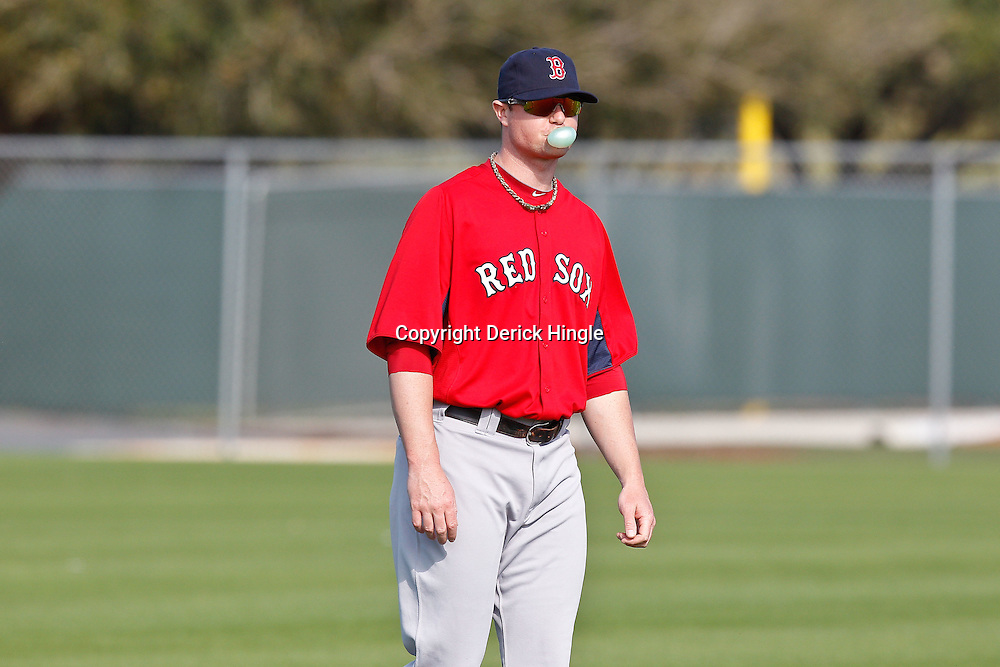 February 18, 2011; Fort Myers, FL, USA; Boston Red Sox starting pitcher Jon Lester (center) during spring training at the Player Development Complex.  Mandatory Credit: Derick E. Hingle