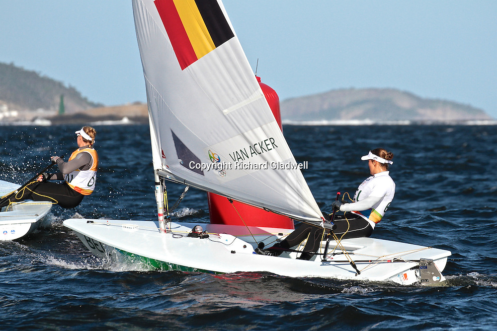 Evie van Acker (BEL) reported to be suffering from a illness picked up in Guanabara Bay, appeared to be in fine form today, winning one race, placing second in another and lying fourth overall - Day 6.<br /> Rio 2016 Olympics, Rio de Janero, Brazil. Olympic Sailing Day 6, 13 August 2016.<br /> Photo credit: Richard Gladwell / www.photosport.nz