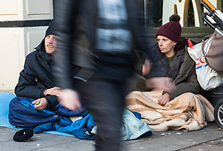 "Tracy, 49, and James, 35 on their pitch outside McDonalds on the High Street, opposite Windsor Castle. After a public outcry against their ""homelessness support strategy"" where rough sleepers would have been fined £100, Windsor council has shelved their plans. Windsor, Berkshire, February 16 2018."