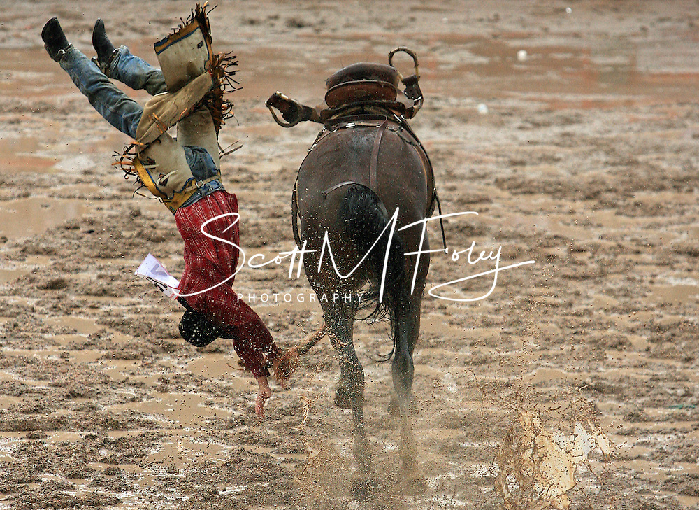 Rookie Saddle Bronc Rider Rhys Lincoln Angland gets flipped by 174 Mary Bell JK, 28 July 2007, Cheyenne Frontier Days