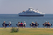 Sylt, Germany. The Syltfähre (Sylt ferry) entering List harbor under the watchful eyes of tourists.