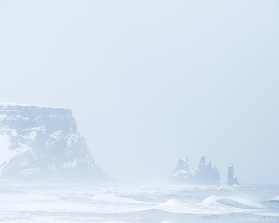Reynisdrangar sea stacks in winter. Overlook towards east from the lower part of Dyrhólaey Peninsula, South Iceland.