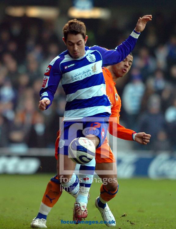 London - Saturday January 31st, 2009: Lee Cook of QPR in action against Liam Rosenior of Reading during the Coca Cola Championship match at Loftus Road, London. (Pic by Focus Images)