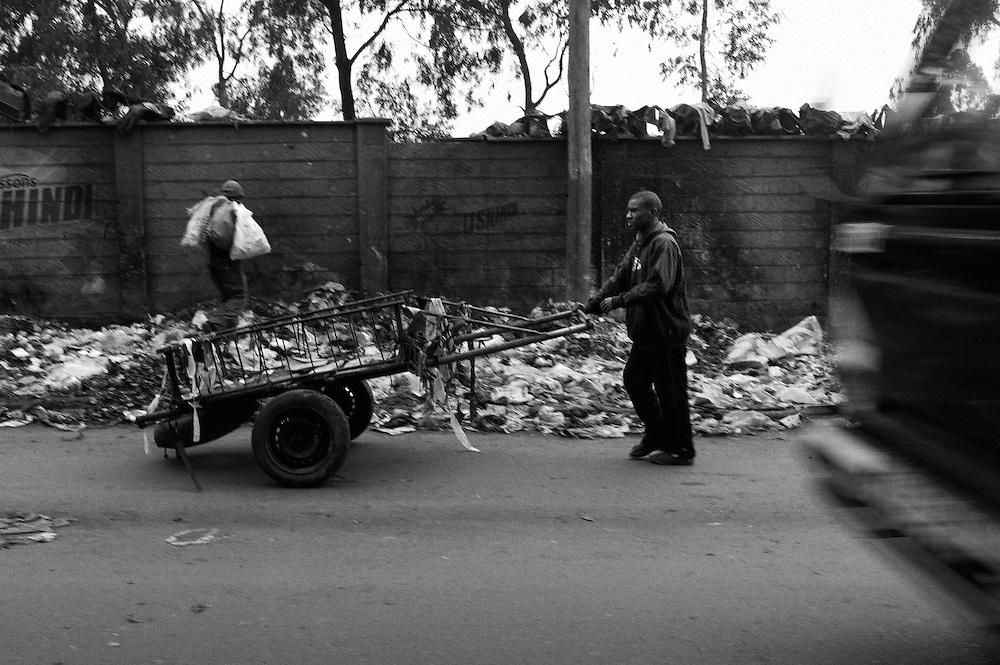 "NAIROBI, KENYA - AUGUST 15, 2011: Members of the Gange Youth Self Help Group in Kibera gather trash and transport it to a local dump site four to five times a day to generate income. Gange, which means ""hard working,"" was started in 1996, and was the first youth reform project to take root in Kibera. Rashid Seif, 28, is a member of Gange Youth. ""We manage to go on with our life. For now, we can make peace. We want to be a peacemaker. We must come with our own vision. We have the idea to be stronger than last election. In the past election the money was the problem. When you show youth money, you encourage them to do whatever you want. We want the creation of jobs, not just to be given money. We say to the politician, 'We don't want your money, we want job opportunity, job creation.' But the government are not thinking about the youth and the community. They leave the youth struggling in their yards. We struggle with this work.""<br />