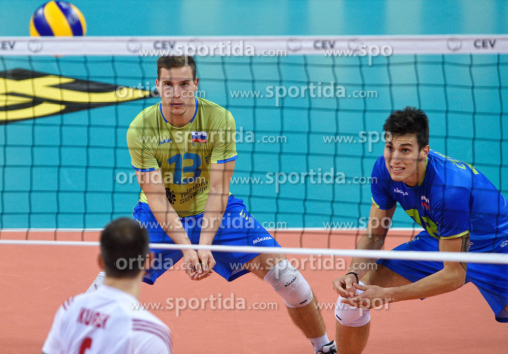 Jani Kovacic #13, Klemen Cebulj #18 during volleyball match between National teams of Poland and Slovenia in Quarterfinals of 2015 CEV Volleyball European Championship - Men, on October 14, 2015 in Arena Armeec, Sofia, Bulgaria. Photo by Ronald Hoogendoorn / Sportida