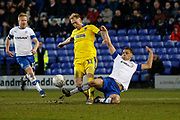 Mitch Pinnock of Wimbledon is tackled by Kieron Morris of Tranmere Rovers  during the EFL Sky Bet League 1 match between Tranmere Rovers and AFC Wimbledon at Prenton Park, Birkenhead, England on 21 December 2019.
