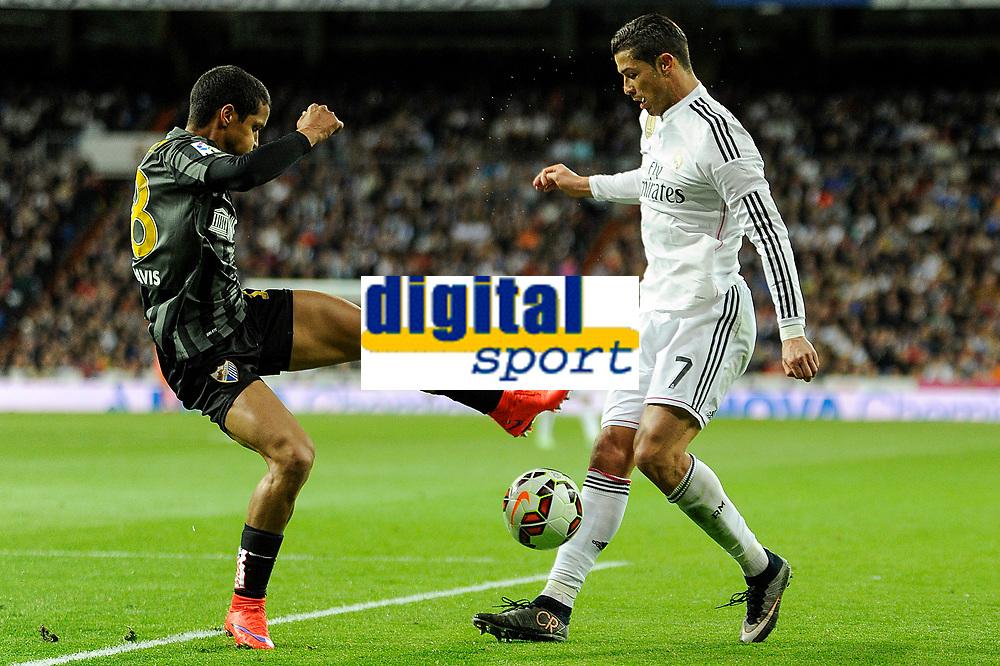 Real Madrid´s Cristiano Ronaldo and Malaga´s Roberto Jose Rosales during 2014-15 La Liga match between Real Madrid and Malaga at Santiago Bernabeu stadium in Madrid, Spain. April 18, 2015. (ALTERPHOTOS/Luis Fernandez)