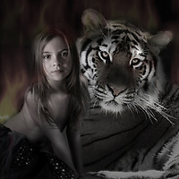 young child sitting with a tiger near a fire with flames behind.