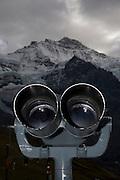 Top of Europe, Fernrohr auf dem Jungfraujoch. Aussichten auf die Bergriesen Eiger, Mönch und Jungfrau sowie auf den längsten Gletscherstrom der Alpen. Das Jungfrau-Aletschgebiet mit der einzigartigen Pflanzen- und Tierwelt ist das erste Unesco Weltnaturerbe im ganzen Alpengebiet. .Journey to the Jungfraujoch - Top of Europe, at 3454 metres Europe's highest altitude railway station, a highlight of every visit to Switzerland. It offers a high-Alpine wonderworld of ice, snow and rock, which can be marvelled at from vantage terraces, the Aletsch Glacier or in the Ice Palace.The train journey to the Jungfraujoch through the rock of the Eiger and Mönch is an incredible experience.Visitors can enjoy stunning views from two intermediate stations, the Eigerwand (Eiger Wall) and Eismeer (Sea of Ice).  © Romano P. Riedo