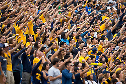 BERKELEY, CA - SEPTEMBER 12:  California Golden Bears fans cheer during the second quarter against the San Diego State Aztecs at California Memorial Stadium on September 12, 2015 in Berkeley, California. The California Golden Bears defeated the San Diego State Aztecs 35-7. (Photo by Jason O. Watson/Getty Images) *** Local Caption ***