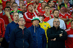 LILLE, FRANCE - Friday, July 1, 2016: Wales supporters look apprehensive during the UEFA Euro 2016 Championship Quarter-Final match against Belgium at the Stade Pierre Mauroy. (Pic by David Rawcliffe/Propaganda)
