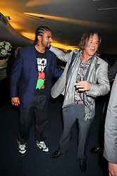 Left to right, DAVID HAYE and MICKEY ROURKE at the annual GQ Awards held at the Royal Opera House, Covent Garden, London on 8th September 2009.