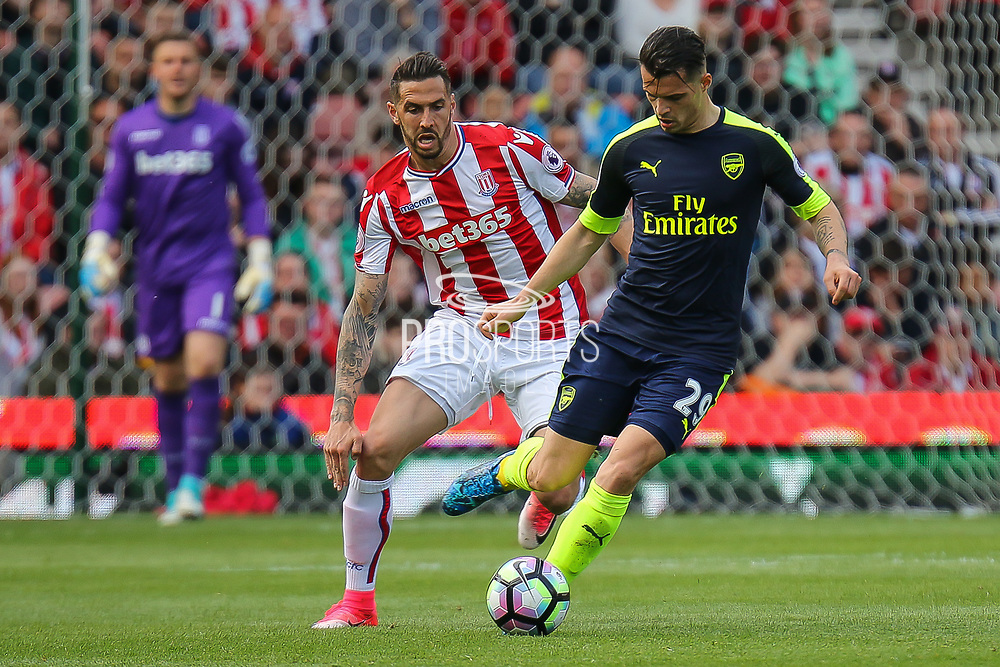 Arsenal midfielder Granit Xhaka clears the ball during the Premier League match between Stoke City and Arsenal at the Bet365 Stadium, Stoke-on-Trent, England on 13 May 2017. Photo by Aaron  Lupton.