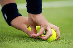 LONDON, ENGLAND - Tuesday, June 26, 2012: A ball boy picks up new tennis balls during the Ladies' Doubles 1st Round match on day two of the Wimbledon Lawn Tennis Championships at the All England Lawn Tennis and Croquet Club. (Pic by David Rawcliffe/Propaganda)