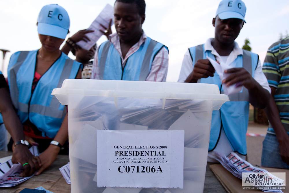Electoral commission workers count ballots after the first round of presidential elections in Accra, Ghana on Sunday December 7, 2008.