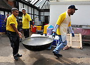 WATFORD HERTFORDSHIRE: Men carry a large pot away after it was washed after serving some of the 60 thousand free meals given out. Over 55,000 pilgrims and guests visit the Largest Hindu Festival in Europe at Bhaktivedanta Manor Krishna Temple near Watford on Sunday 5th September to celebrate Janmashtami the birth of Lord Krishna. The Manor was donated to the Hare Krishna Movement in the early 1970s by former Beatle George Harrison. 03 SEPT 2010. STEPHEN SIMPSON ..