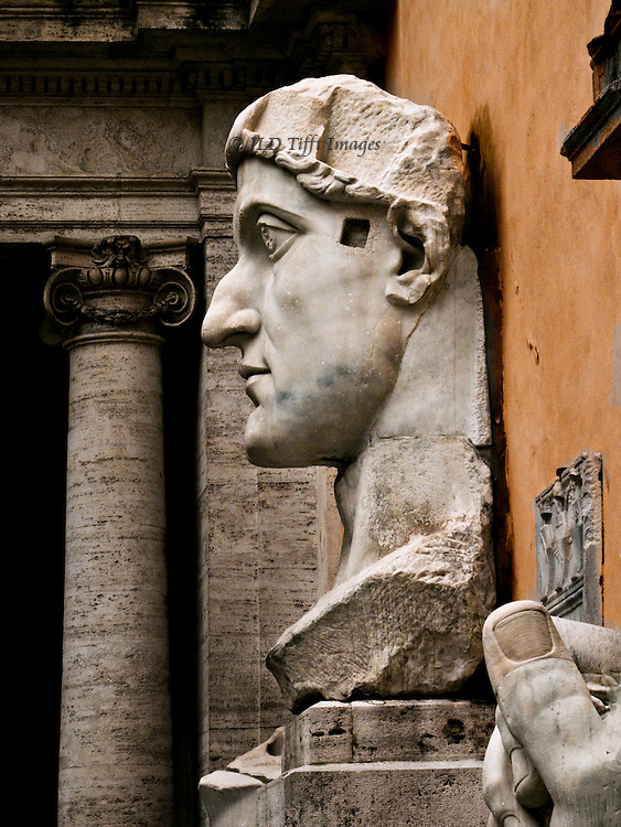 Constantine the Great, gigantic head in profile, with pointing thumb from the detached hand.
