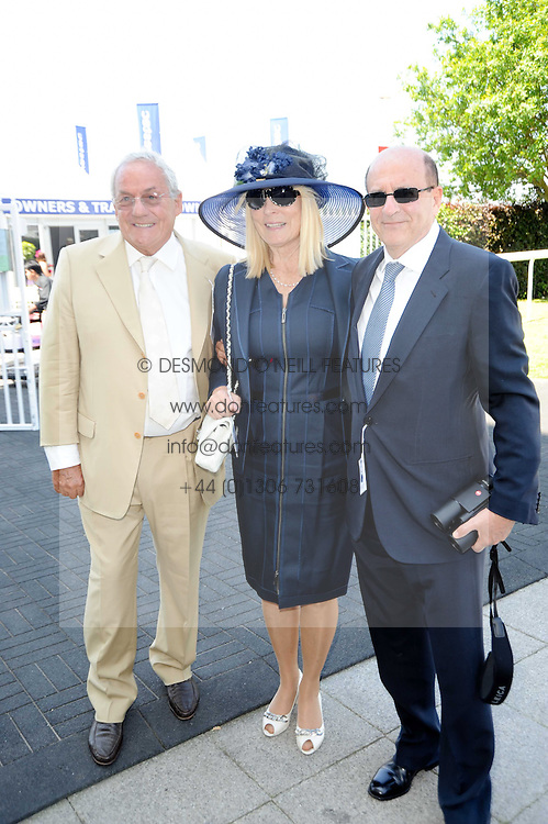 Left to right, JOHNNY GOLD and MR & MRS MICHAEL TABOR at the Investec Ladies Day at Epsom Racecourse, Surrey on 4th June 2010.