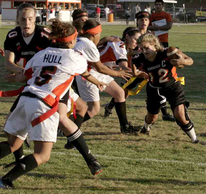Senior Amy Green (12) runs with the ball at the 3rd Annual Powderpuff Challenge, pitting the junior girls (class of 2008) against the senior girls (class of 2007.)  While the senior girls won, 14-0, the junior girls put together a goal line defense to keep Amy and the seniors from scoring when they were on the one yard line at the end of the fourth quarter.