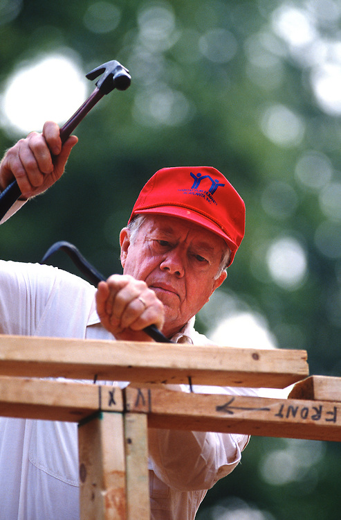 Former President Jimmy Carter works on Habitat for Humanity house in Atlanta, Georgia. Carter is a founding board member and a worldwide ambassador for the nonprofit. - To license this image, click on the shopping cart below -