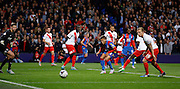 Dwight Gayle winches as he can't quite get on the end of the driven ball in during the Capital One Cup match between Crystal Palace and Charlton Athletic at Selhurst Park, London, England on 23 September 2015. Photo by Michael Hulf.