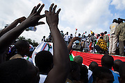 A Convention People's Party (CPP) holds his hands up during a rally in Accra, Ghana on Sunday September 21, 2008.