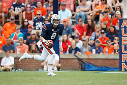 Auburn Tigers quarterback Jarrett Stidham (8) rolls out to pass during an NCAA football game against the Mississippi Rebels, Saturday, October 7, 2017, in Auburn, AL. Auburn won 44-23. (Paul Abell via Abell Images for Chick-fil-A Peach Bowl)