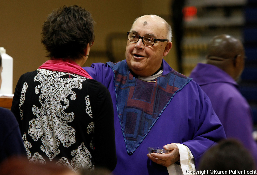 Students and teachers from St. Benedict at Auburndale Catholic School in Cordova, Tennessee receive ashes on Wednesday. MONSIGNOR BUCHIGNANI places ashes on the students heads during the Ash Wednesday mass.