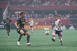 August 1, 2018 - Atlanta, Georgia, United States - MLS All-Star forward SEBASTIAN GIOVINCO, 12, (Toronto FC) controls the ball abasing Juventus forward STEFANO BELTRAME, 41 during the 2018 MLS All-Star Game at Mercedes-Benz Stadium in Atlanta, Georgia.   Juventus F.C. defeats  MLS All-Stars defeat  1 to 1  (Credit Image: © Mark Smith via ZUMA Wire)