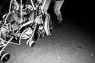 March 2015. Flandre avenue, Paris. mother walks on night with his baby daoughter.