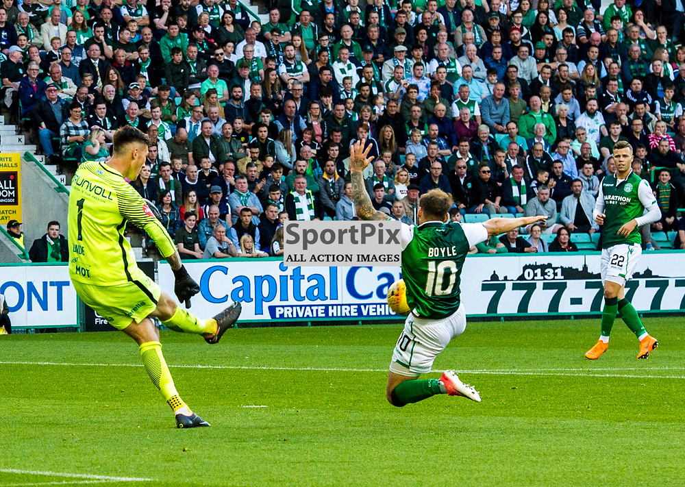 Pictured: Martin Byle puts Andreas Linde under pressure<br /> <br /> Hibs welcomed Molde to Easter Road for their second home game of the Europa League campaign