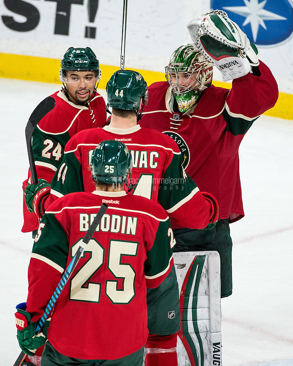 Dec 17, 2016; Saint Paul, MN, USA; Minnesota Wild goalie Darcy Kuemper (35) celebrates with teammates following the game against the Arizona Coyotes at Xcel Energy Center. The Wild defeated the Coyotes 4-1. Mandatory Credit: Brace Hemmelgarn-USA TODAY Sports