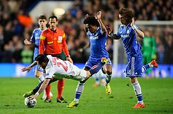 PSG Forward Ezequiel Lavezzi (ARG) goes down as Chelsea Midfielder Willian (BRA) and Chelsea Defender David Luiz (BRA)  challenge - Photo mandatory by-line: Rogan Thomson/JMP - 07966 386802 - 08/04/2014 - SPORT - FOOTBALL - Stamford Bridge, London - Chelsea v Paris Saint-Germain - UEFA Champions League Quarter-Final Second Leg.