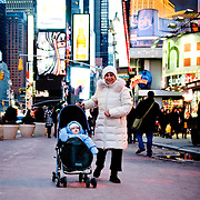 A woman and child in Times Square, New York, February 18, 2010.